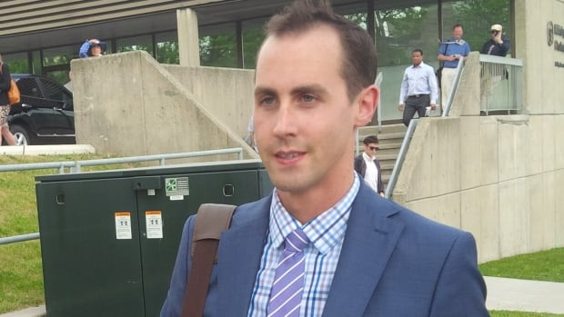 Former Conservative Party worker Michael Sona leaves the courthouse in Guelph, Ont., after the first day of his trial on Monday. Sona is accused of deliberately trying to prevent people from voting by making a misleading robocall that told voters who didn't support the Conservatives that their polling station had moved.