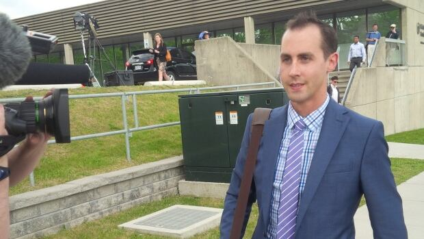 Former Guelph Conservative campaign worker Michael Sona, the only person charged over misleading robocalls in the 2011 federal election, leaves the courthouse in Guelph Monday, June 2 on the first day of his trial.