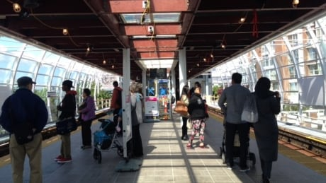 Commuters wait for Skytrain at Main Street