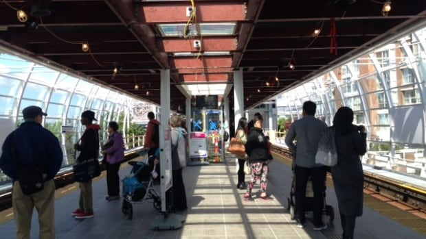 Commuters wait for Skytrain at Main Street-Science World station