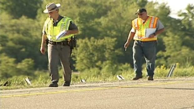 Investigators examine the crash site near Watertown, New York, on Sunday.