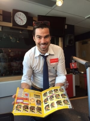 Alex Renowitzky shows off his Panini sticker collection