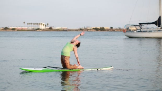 Ashley Bourgeois combines yoga and nature by using paddleboards on the water.