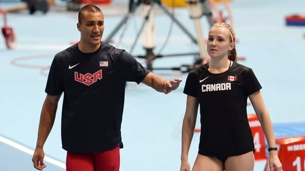Ashton Eaton, left, is shown talking to his wife Brianne Theisen Eaton during the world indoors in Sopot, Poland.