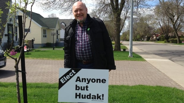 Larry Bringham's anti-Hudak sign in Thunder Bay's north side has attracted the attention of passers by who take photos, as well as Elections Ontario.