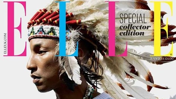 Many fans are not happy with singer Pharrell Williams for posing in a headdress for Elle magazine.