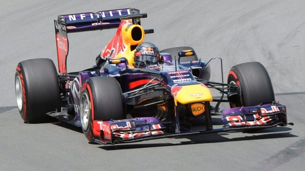 A file photo of Germany's Sebastian Vettel car at the 2013 Montreal Grand Prix. This year cars will only be permitted to consume 100 kg of fuel, down from about the 160 kg they each consume during the race.