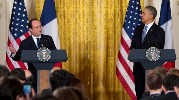 This Feb. 11, 2104 file photo shows President Barack Obama and French President François Hollande during their joint news conference in the White House. Obama has said he will not intervene in reducing penalties and fines levied against French bank BNP Paribas by U.S. regulators, despite Hollande's appeal.