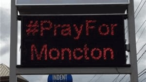 #PrayforMoncton sign posted outside a business