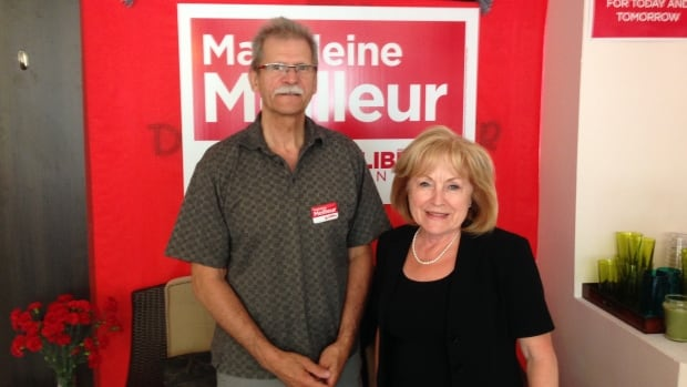 Madeleine Meilleur, here with longtime volunteer Jean-Guy Bradette, said she almost feels insulted when people suggest she doesn't have to work hard for a win.