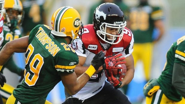 Running back Jon Cornish, right, and his Stampeders teammates, along with Edmonton players, will participate in a strike vote on Saturday. The CFL and its players have been without a collective agreement since May 29.