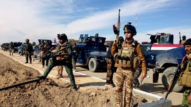 Iraqi security forces prepare to attack al-Qaeda positions in Ramadi, 115 kilometers west of Baghdad, on Feb. 2, 2014.