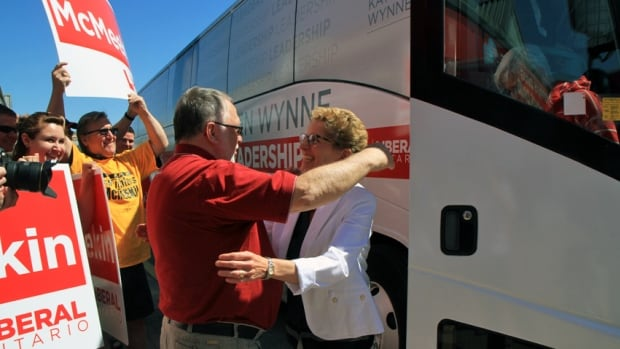 Liberal candidate Ted McMeekin, left, greets Ontario Liberal leader Kathleen Wynne in front of his campaign office in Waterdown, in northern Hamilton.