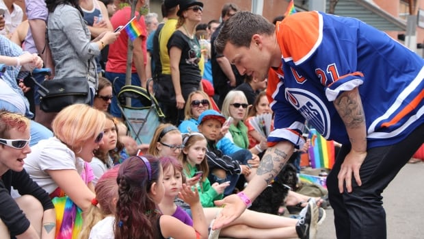 Oilers captain Andrew Ference greeted young fans at the Edmonton Pride Festival parade earlier this month.