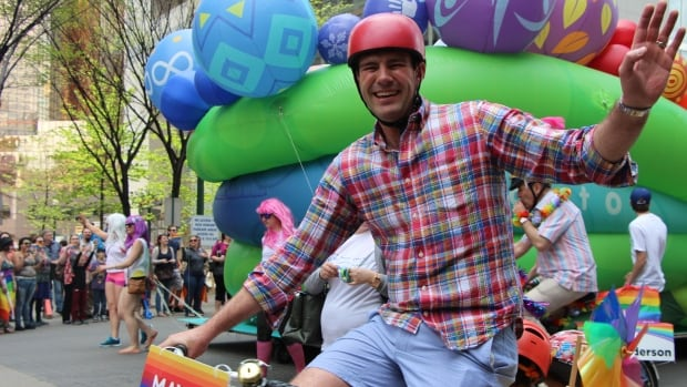 Mayor Don Iveson waves to the crowds downtown during the Edmonton Pride Festival parade in 2014.