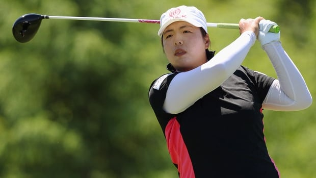 Shanshan Feng watches her tee shot on the fifth hole during third-round play of the Manulife Financial LPGA Classic tournament on Saturday in Waterloo, Ont. Feng shot 4-under 67 to take a two-stroke lead over Hee Young Park.