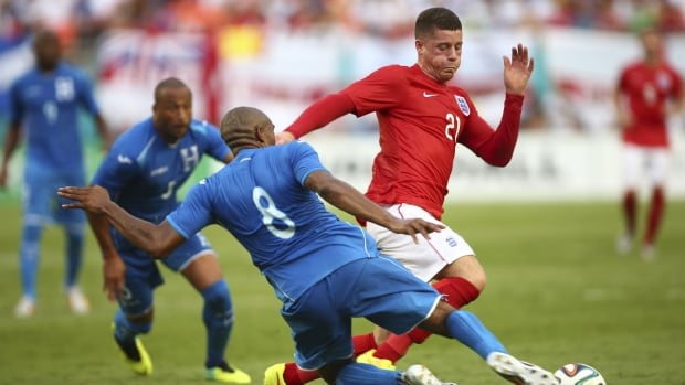 Honduras's Wilson Palacios slides in with a challenge against England's Ross Barkley  during the second half of a friendly soccer match in Miami Gardens, Fla., on Saturday.