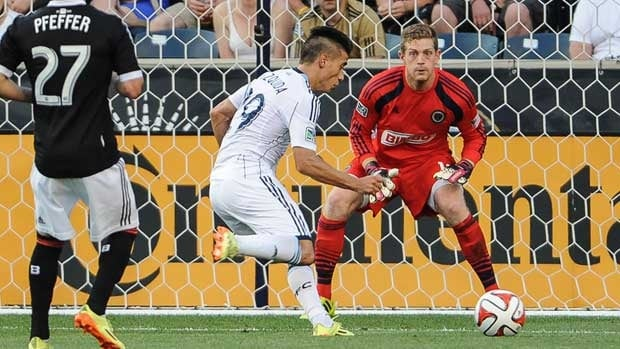Vancouver's Erik Hurtado shoots and scores during the first half of the match against the Philadelphia Union at PPL Park.