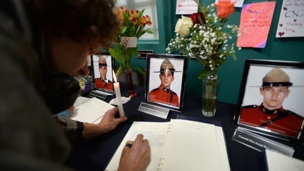 A book of condolence is signed at the Codiac RCMP detachment in Moncton, N.B. on Friday, June 6, 2014 to pay respect to the three RCMP officers who were killed and the two injured in a shooting spree on Wednesday. Justin Bourque, 24, is facing three charges of first-degree murder and two charges of attempted murder.