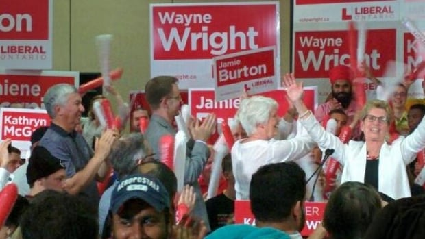 Kitchener Mayor Carl Zehr applauds Liberal leader Kathleen Wynne after giving his first mayoral endorsement to her party.