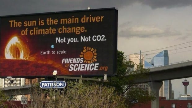 Greenpeace wants to know why its billboard on solar energy was rejected in Edmonton while an ad denying that humans have an impact on climate change is up in Calgary.