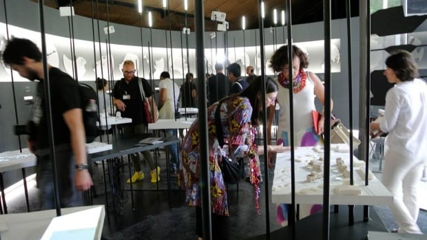 Visitors take in 'Arctic Adaptations: Nunavut at 15.' Canada's display at the Venice Biennale in Architecture is a celebration of the territory's 15th anniversary.