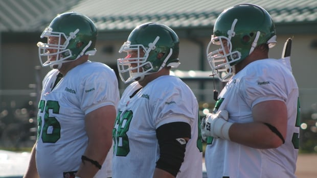 Roughriders player representative Brendon LaBatte (right) says most teammates oppose proposed labour deal.