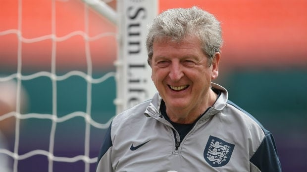 Here is England manager Roy Hodgson in front of a goal post. The goal post just told him a funny joke. (Richard Heathcote/Getty Images)