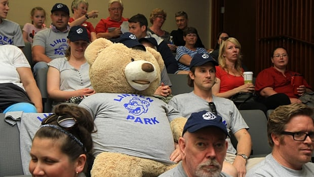 George Baier, a Linden Park parent, sits next to the school's mascot as he waits for trustees to make a decision on the future of the central Mountain school. Public school board trustees voted to close Eastmount Park, Linden Park and Cardinal Heights. In total, trustees have voted to close 10 schools this year and build two new ones, both in Flamborough.