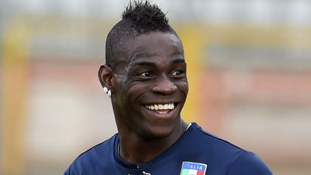 Italy striker Mario Balotelli was all smiles after his girlfriend accepted his marriage proposal.