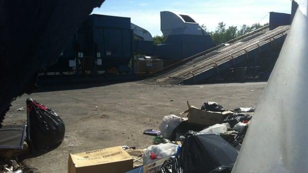 Behind pieces of torn plastics, Nova Scotian inventor John Kearns's waste disposal machine sits idle near Six Nations' landfill site.