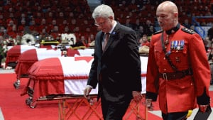 Prime Minister Stephen Harper and RCMP Commissioner Bob Paulson at funeral for Moncton Mounties