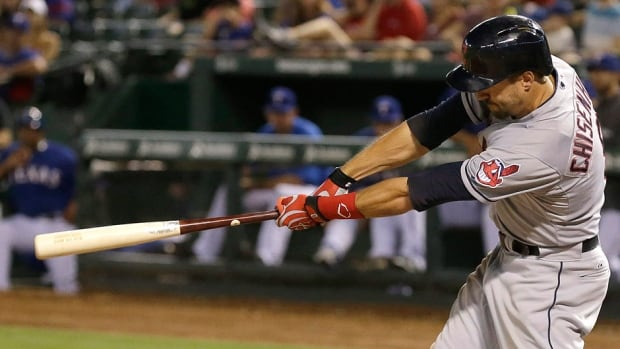 Indians third baseman Lonnie Chisenhall follows through on a swing hitting a three-run homer on Monday night in Texas. Chisenhall hit three homers on the night, finishing 5-for-5 with nine runs batted in to tie a franchise record. His bat will go to the Hall of Fame.