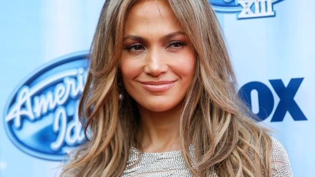Earlier reports stated that Lopez, 44, would not be performing at the opening ceremony of the World Cup on Thursday. The singer told The Associated Press, however, that she was on her way to Brazil.