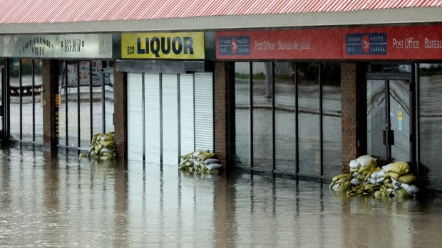 Flooded stores in Black Diamond after heavy rains closed roads and forced evacuations in the town last June.