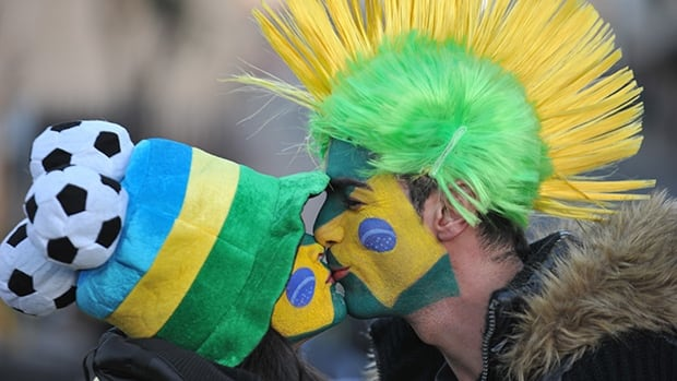 These two Brazilian soccer fans may have to move up their romantic celebrations a day early if they want to watch their club open the World Cup.
