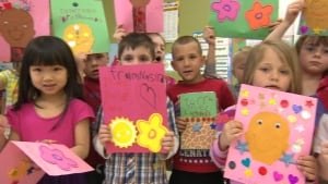 School kids at St. Andrew's Elementary make cards for Torrence Collier