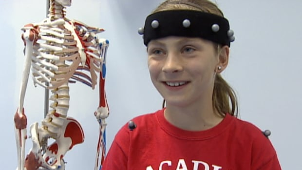 Sydney Cummings, 10, sports sensors attached to her clothing.