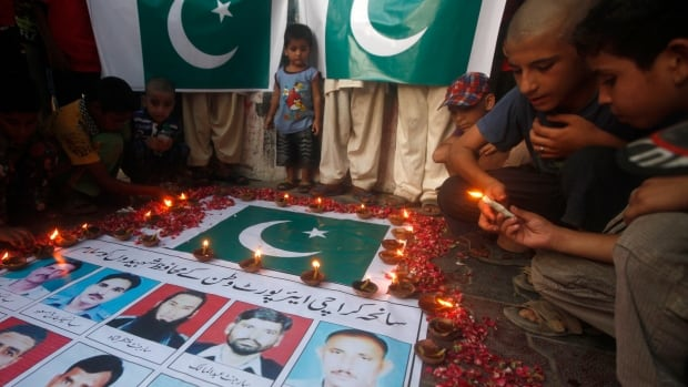 Children light candles to commemorate the members of Airport Security Force (ASF) who were killed on Sunday's Taliban attack on Jinnah International Airport. The attack, and another that occurred just one day after, may indicate the Taliban are learning from deadly militant attacks elsewhere.