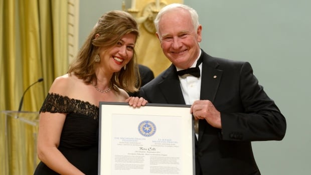 Rita Celli with Governor General David Johnston as she receives the Michener-Deacon Fellowship for investigative reporting.
