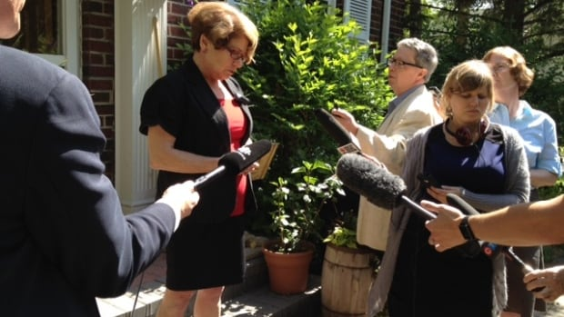 Judy Wasylycia-Leis announces part of her mayoral campaign platform outside her house in Winnipeg on Thursday.