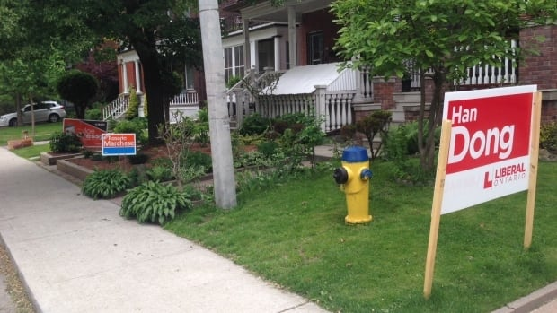 Signs along a residential street in the Trinity-Spadina riding must come down within 72-hours of the vote.