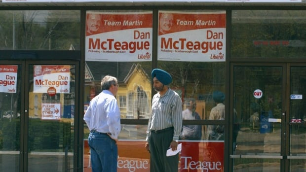 Then-Liberal MP Dan McTeague talks with campaign volunteer Gobinder Randhawa outside his election campaign office in Pickering, Ont., in 2004. McTeague lasted seven more years as an MP before losing in the 2011 federal election.