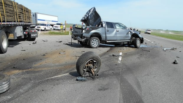 The driver of a pickup truck was killed in a collision on the QEII Highway near Calgary on Thursday morning.