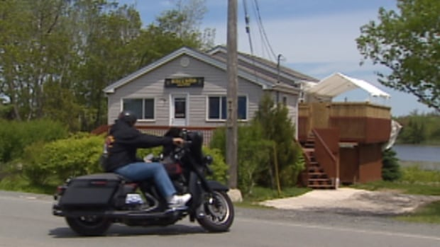 A biker arrives at the Harrietsfield clubhouse in the Halifax region.
