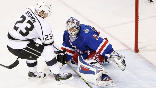 Kings captain Dustin Brown (23) scores on Henrik Lundqvist in a 2-1 road loss to the Rangers in Game 4 on Wednesday night.