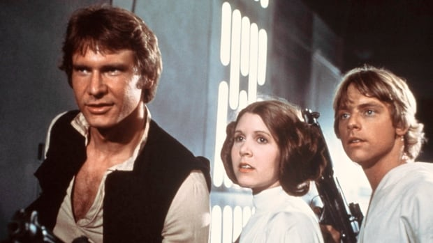 Harrison Ford, Carrie Fisher and Mark Hamill are shown in a scene from Star Wars. A shooting script from the 1977 film was discovered at the University of New Brunswick in Saint John.