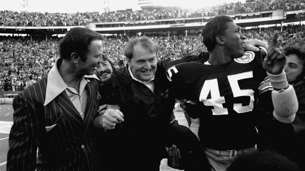 Pittsburgh Steelers coach Chuck Noll, centre, is shown after the team's Super Bowl win in 1978.