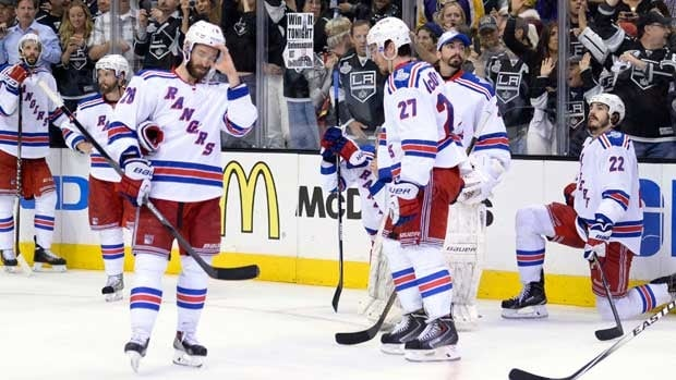 New York Rangers players look on dejectedly after Los Angeles took Game 5, and the Stanley Cup.