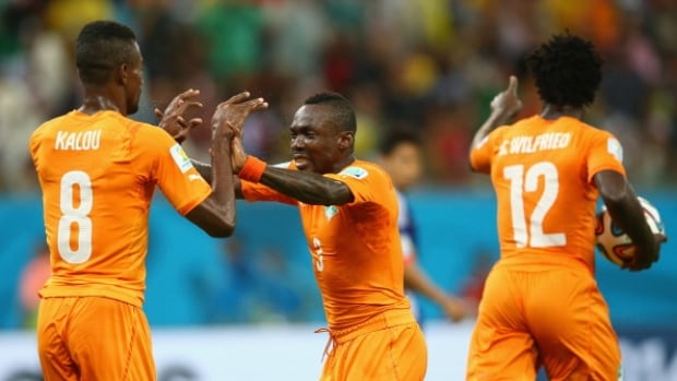 Cote d'Ivoire Wilfried Bony celebrates scoring against Japan with teammates Salomon Kalou, left, and Arthur Boka during Group C action on Saturday at Arena Pernambuco in Brazil.